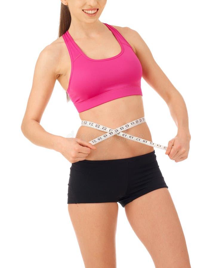 Woman measuring her abdomen stock photo