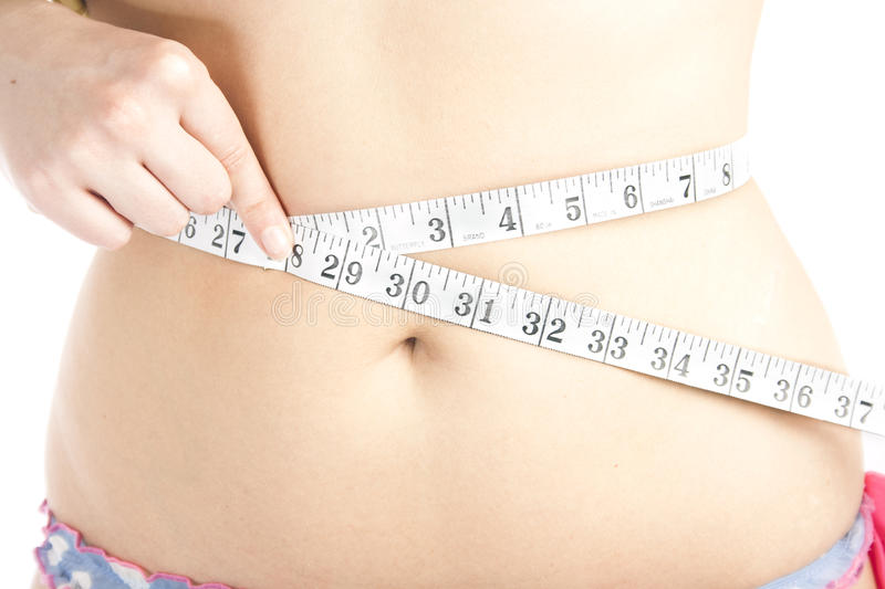 Woman measuring her belly royalty free stock photography