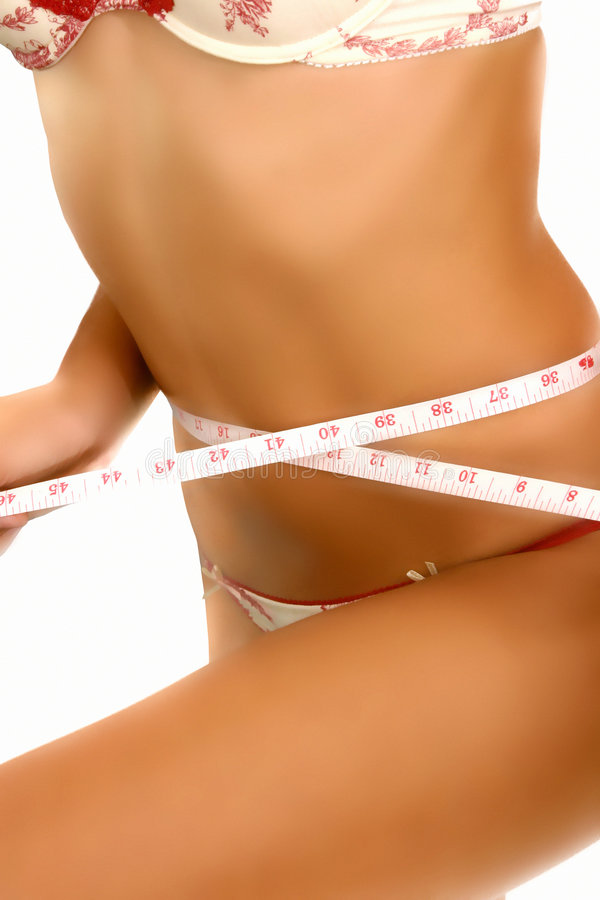 Woman measuring her body royalty free stock photography