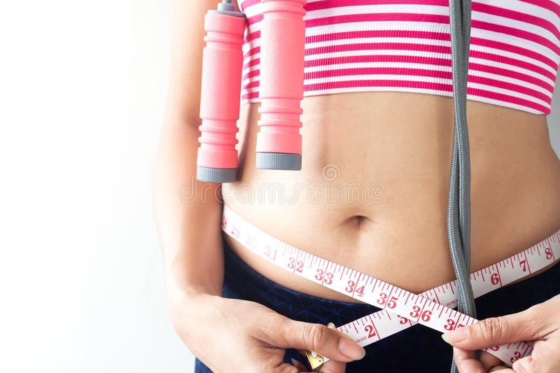 Woman measuring her body, Healthy and Diet lifestyle royalty free stock image