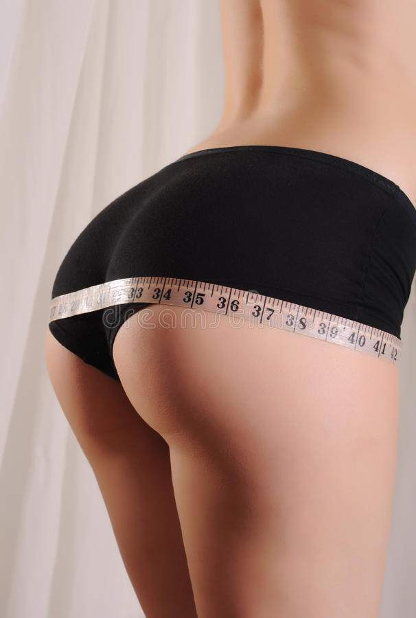 Woman measuring her hips . Healthy lifestyles concept royalty free stock photos