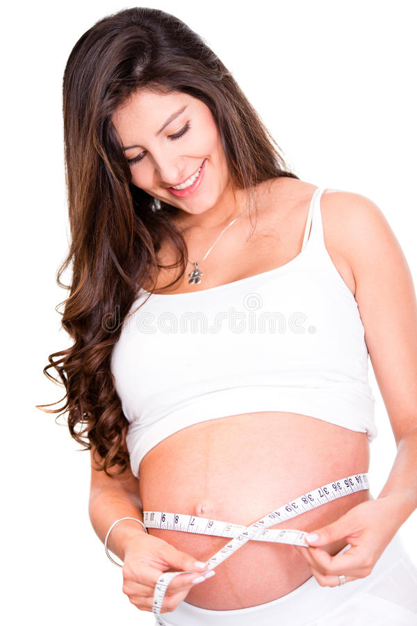 Download Woman Measuring Her Pregnant Belly Stock Photo - Image: 27092926