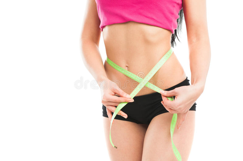 Woman measuring her waistline. Isolated on white stock images