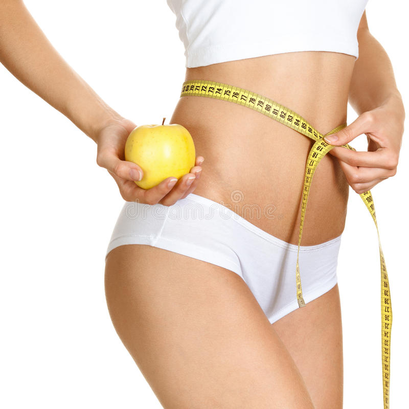 Woman measuring her waistline. Perfect Slim Body. Diet stock images
