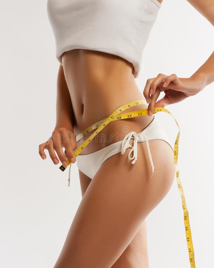 Woman measuring her waistline . royalty free stock image