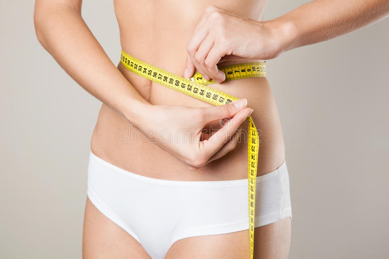 Woman measuring her waistline. Perfect Slim Body stock photo