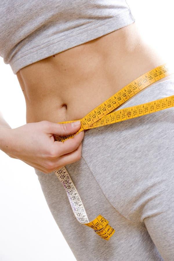 Woman measuring hips stock image
