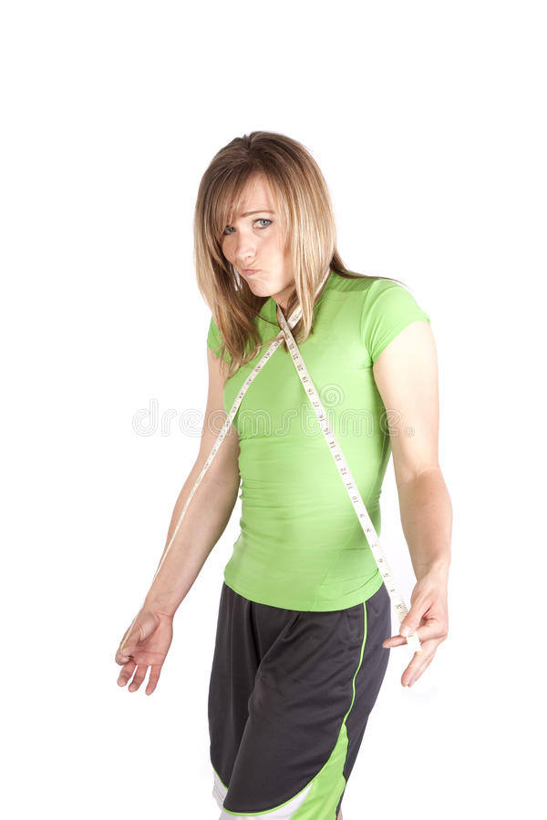 Woman with measuring tape around neck funny face royalty free stock photo