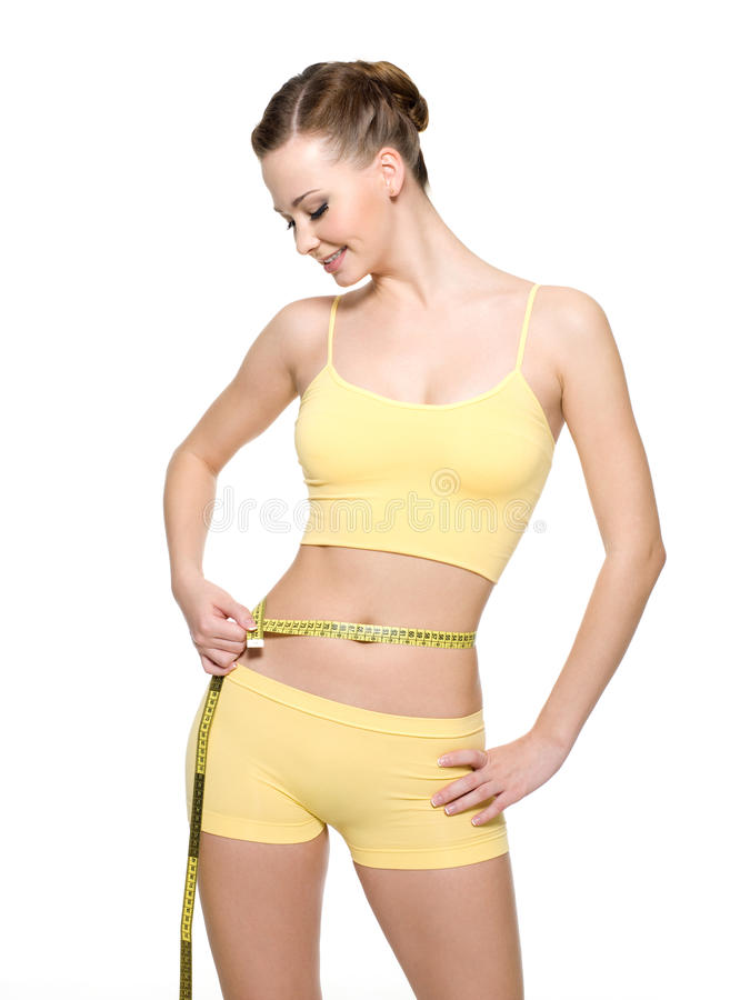 Woman measuring waist with measurement type stock images