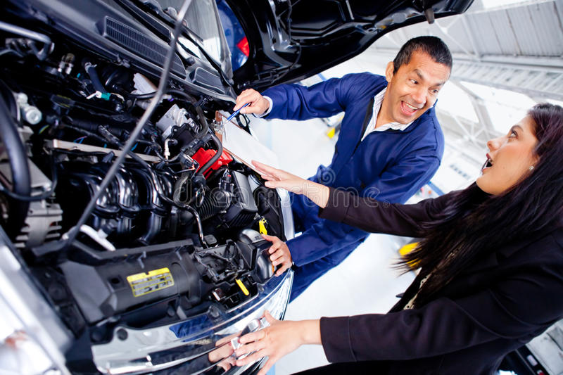 Download Woman at the mechanic stock image. Image of support, assistance - 23877967