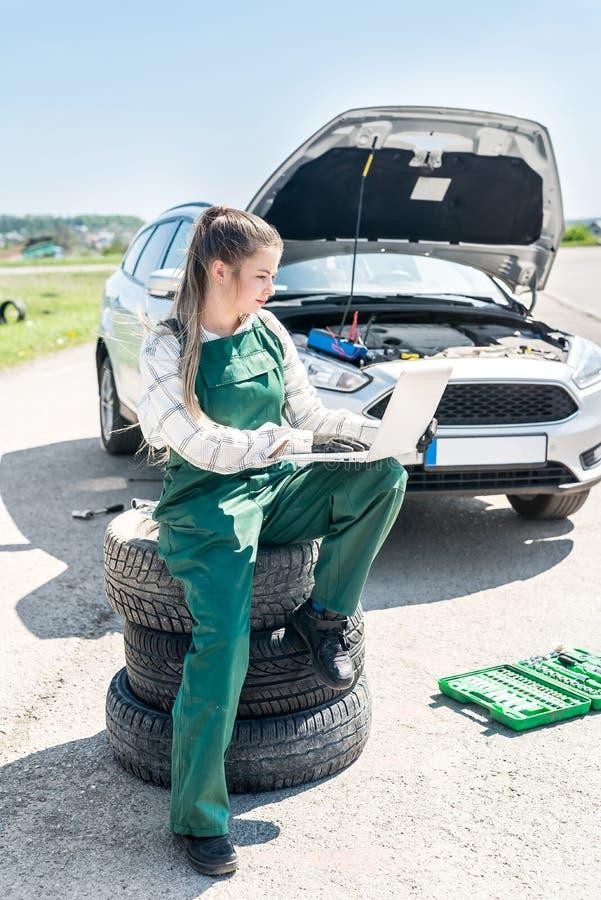 Woman Mechanic Repairing Car On Roadside Stock Image - Image
