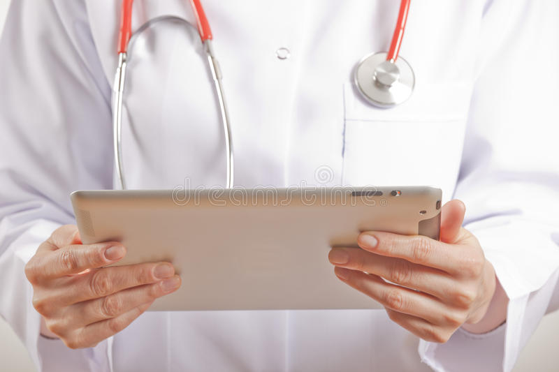 Woman Medical Doctor Using Tablet Pc Stock Images