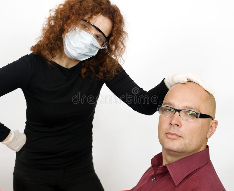 Download Woman In Medical Mask Keeps Man For Head Stock Photo - Image of holding, woman: 11118326