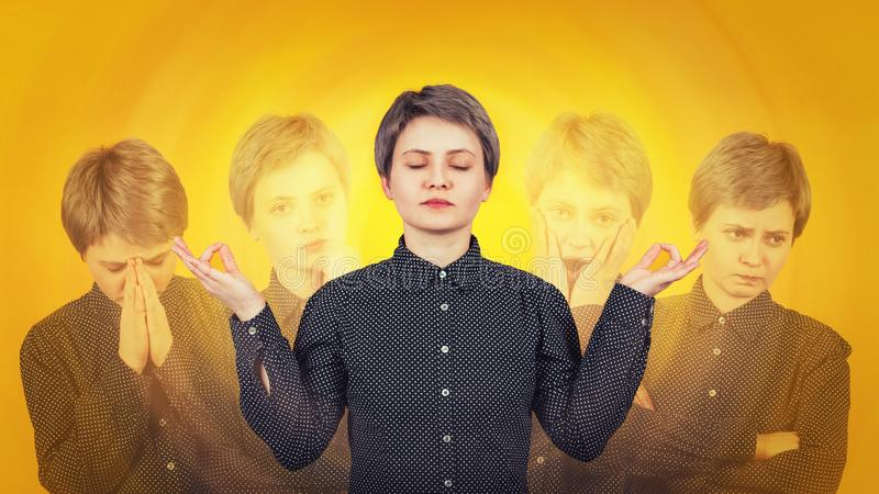 Woman meditate as suffer split emotions. Multipolar mental health disorder concept. Schizophrenia psychiatric disease. Young woman meditate as suffer split royalty free stock images