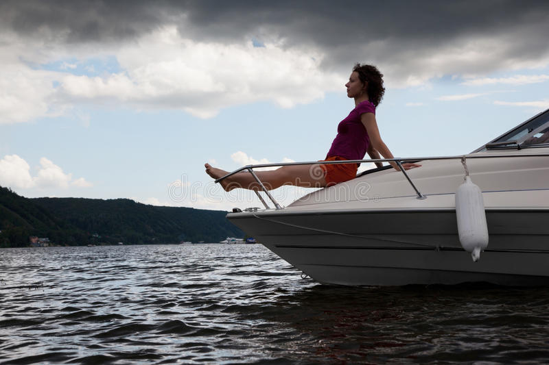 Download Woman Meditate On Bow Of Cutter Stock Image - Image: 27107951