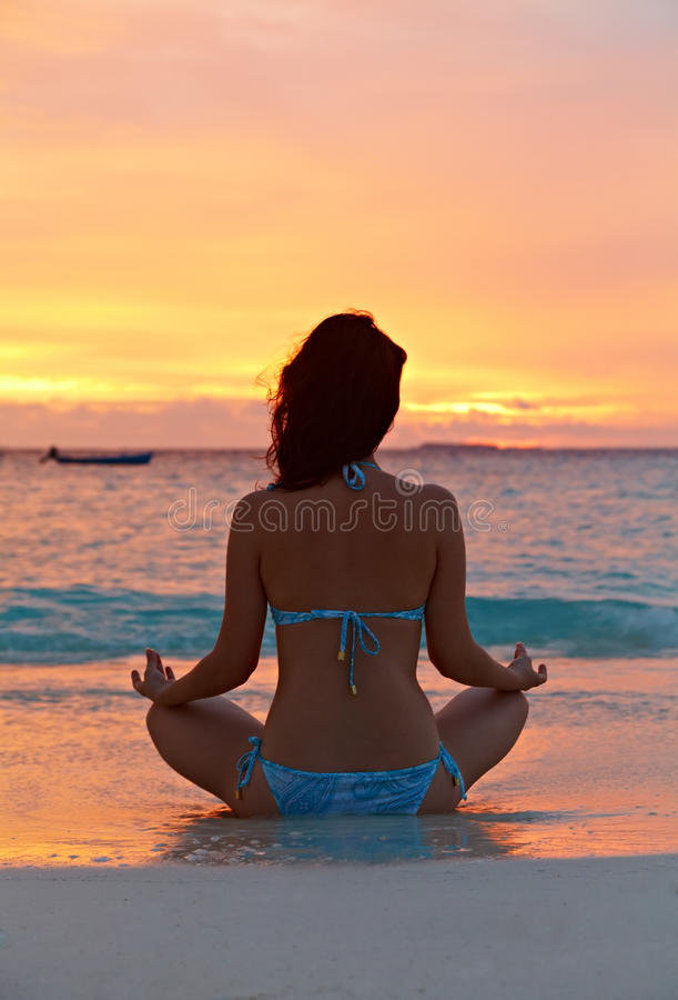 Download Woman meditating stock photo. Image of orange, blue, evening - 23710142