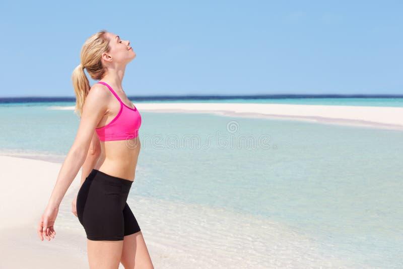 Download Woman Meditating On Beautiful Beach Stock Photo - Image: 30330130