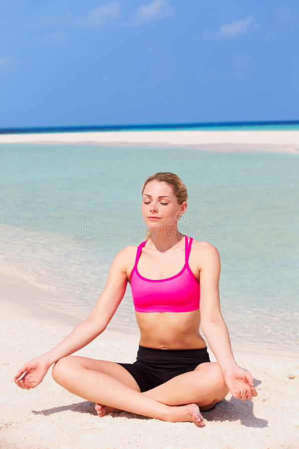Download Woman Meditating On Beautiful Beach Stock Photo - Image: 30330150