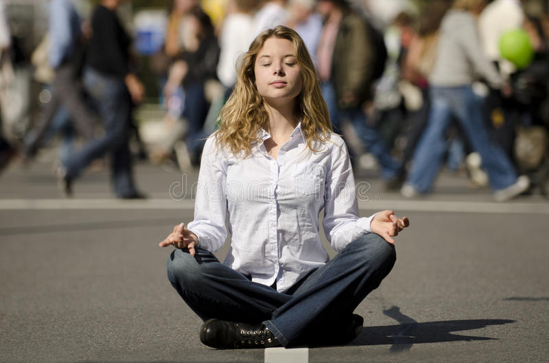 Download Woman Meditating In Busy Urban Street Stock Image - Image of outdoors, pretty: 21322889