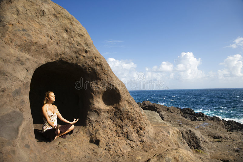 Download Woman meditating in cave. stock image. Image of beach - 2424285