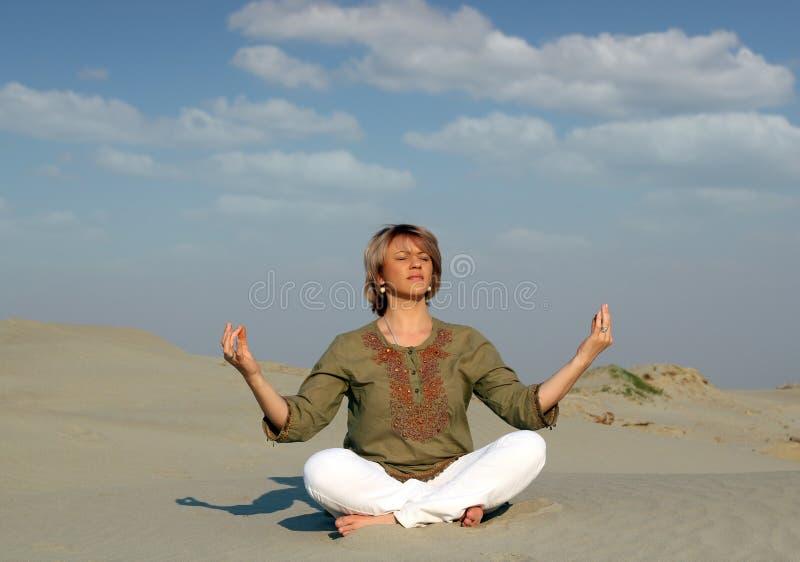 Download Woman Meditating In Desert Stock Images - Image: 27065084