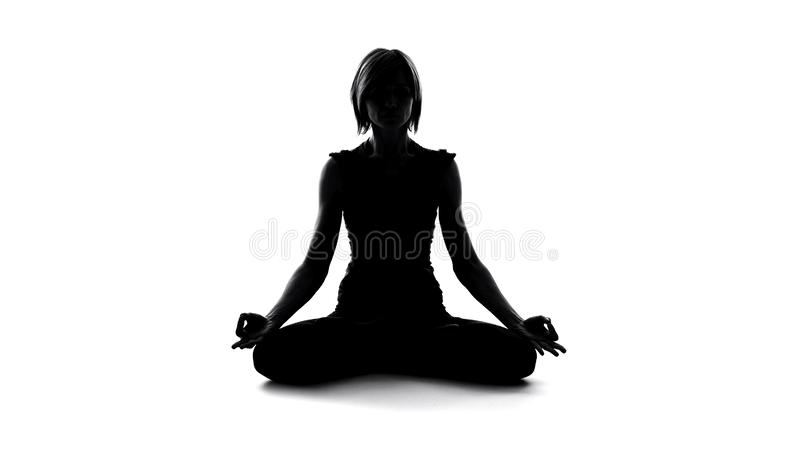 Woman meditating in lotus pose, healthy lifestyle, body and soul harmony, relax royalty free stock photos