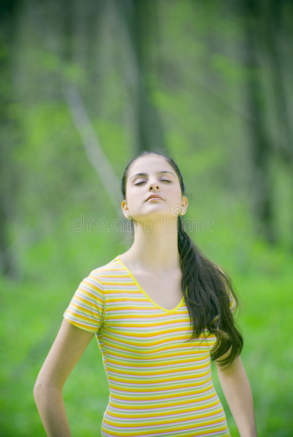 woman meditating outdoors stock photo