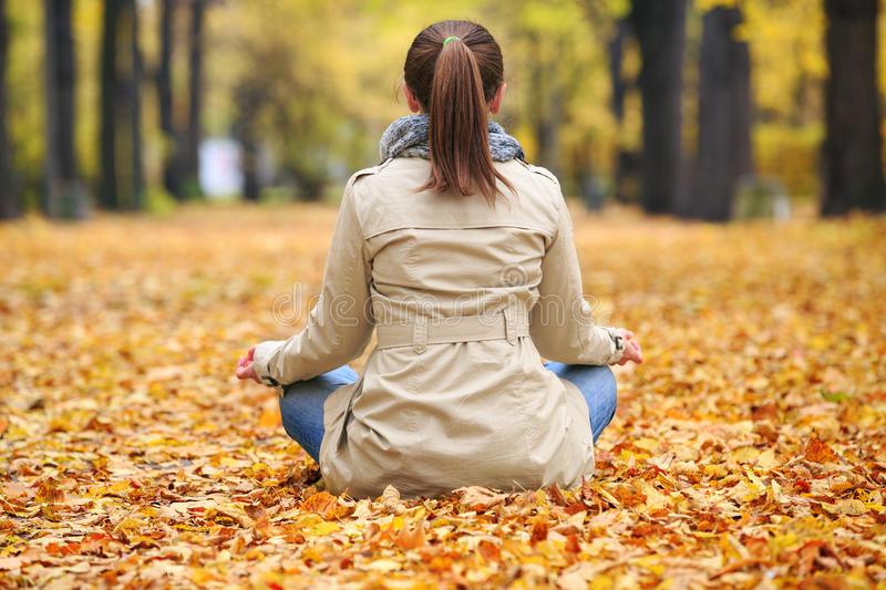 Woman meditating royalty free stock photos
