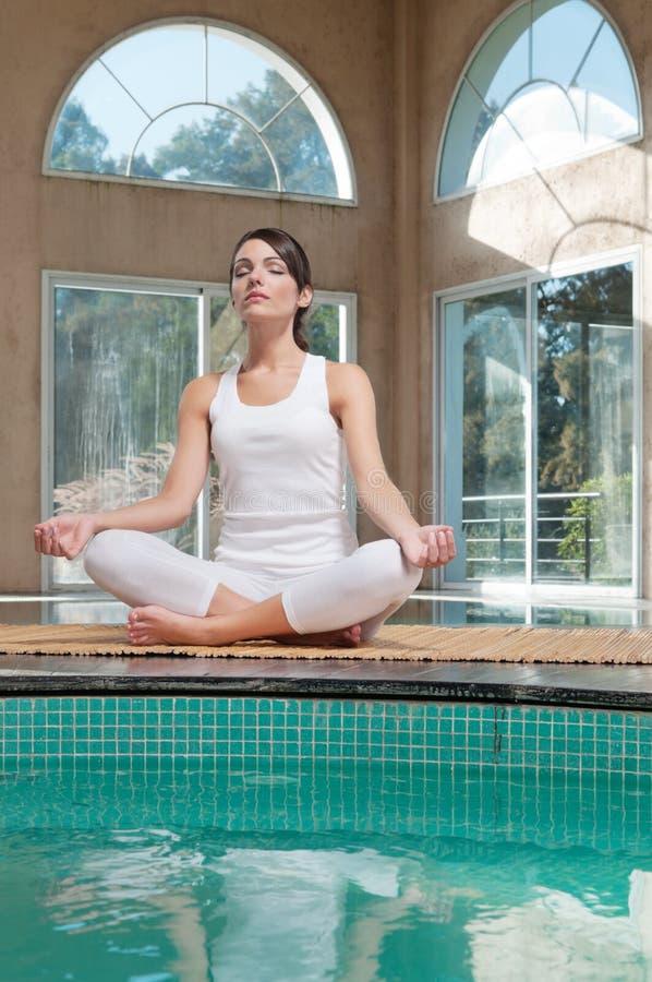 Download Woman Meditating Sitting In Lotus Position Stock Image - Image: 19614691