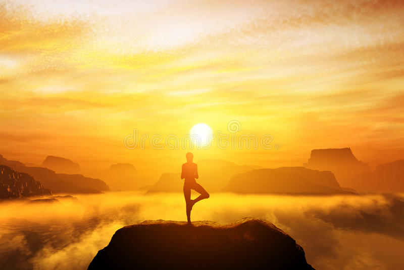 Woman meditating in tree yoga position stock image
