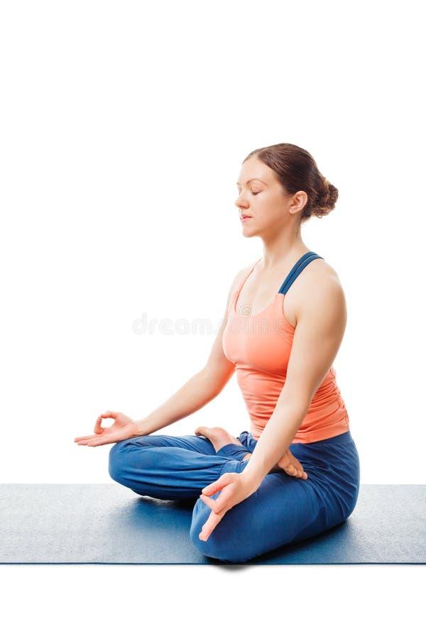 woman meditating in yoga asana padmasana lotus pose stock photo