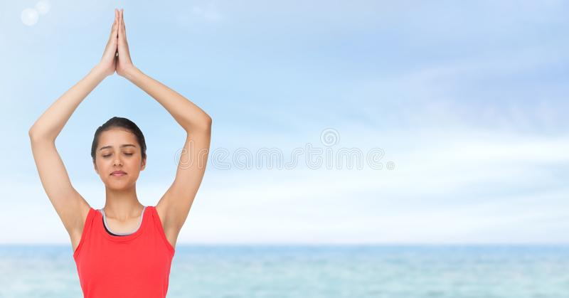 Woman Meditating yoga by sea royalty free stock photos