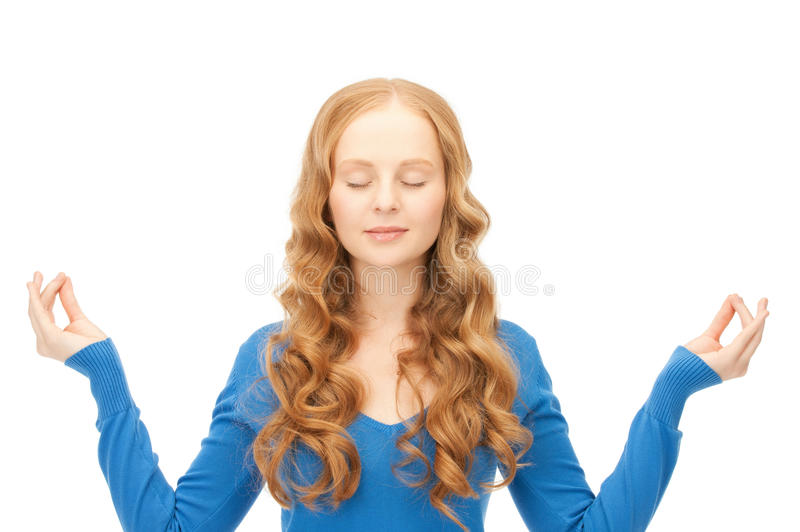 Woman in meditation. Bright picture of woman in meditation over white royalty free stock photography
