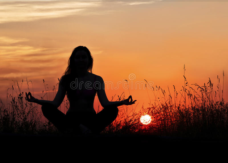 Woman in meditation on the street, amid zakata.yoga. stock image