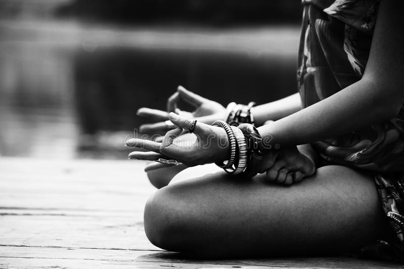 Woman in a meditative yoga position lower body bw royalty free stock image