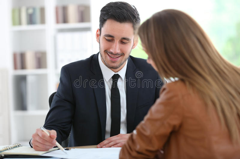 Woman meeting financial advisor. Woman meeting financial adviser in office stock image