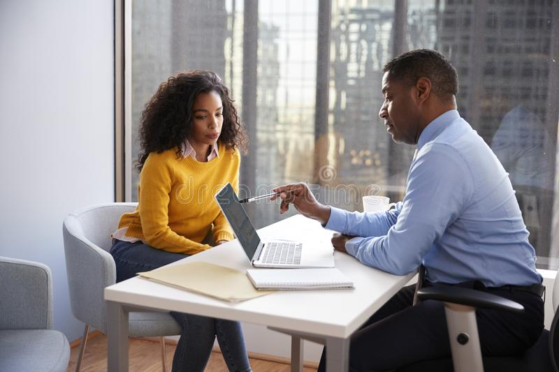 Woman Meeting With Male Financial Advisor Relationship Counsellor In Office royalty free stock images