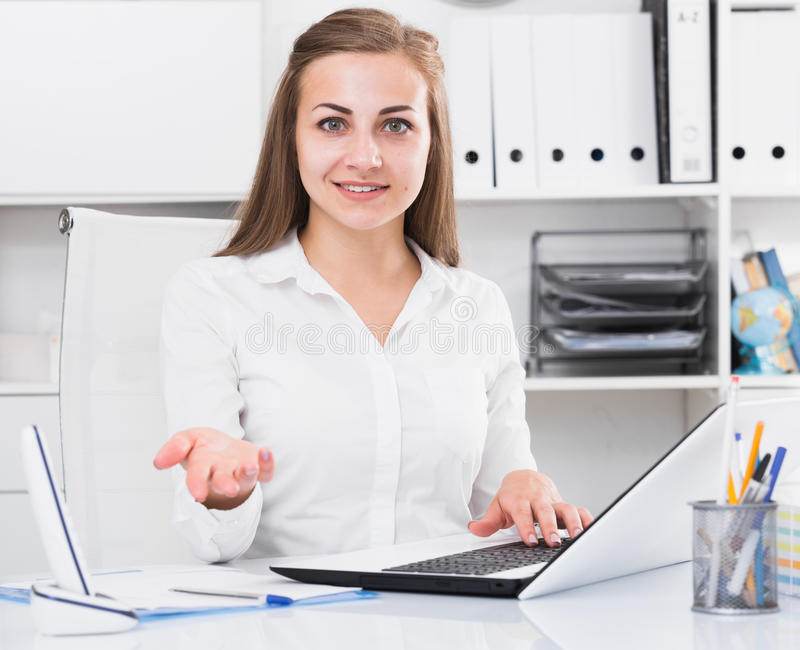 Woman is meeting new client behind the table royalty free stock photo