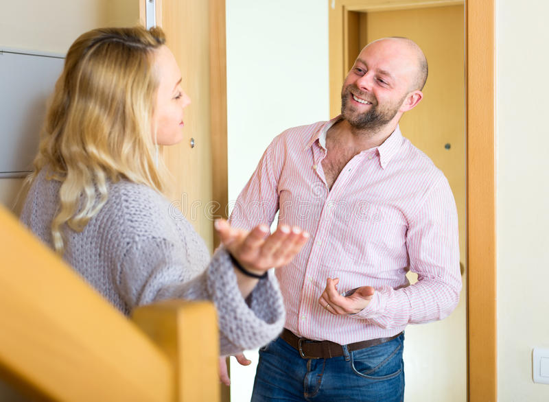 Woman meets man by the door royalty free stock photo