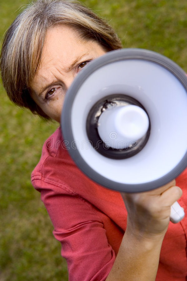 Woman with megaphone. Middle-aged woman with a megaphone royalty free stock images