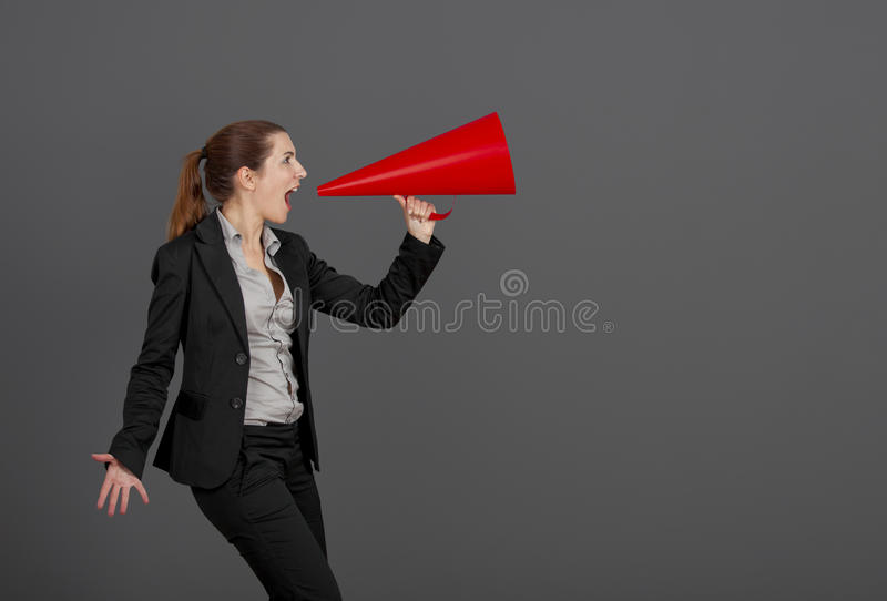 Woman with a megaphone royalty free stock photos