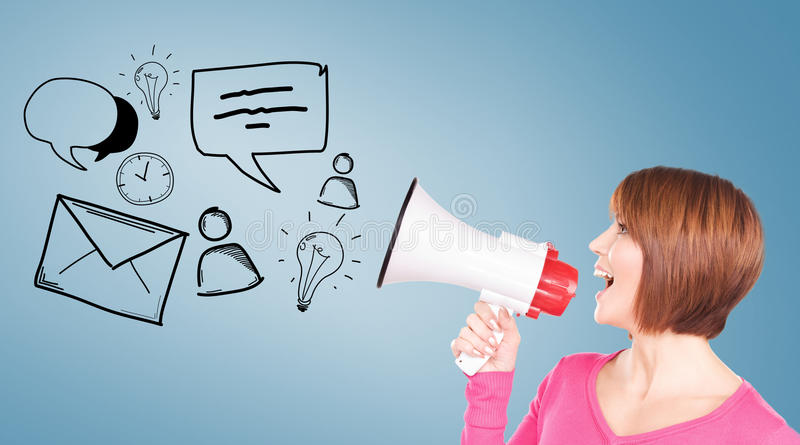 Woman with megaphone. Communication concept - woman with megaphone over blue background stock photo