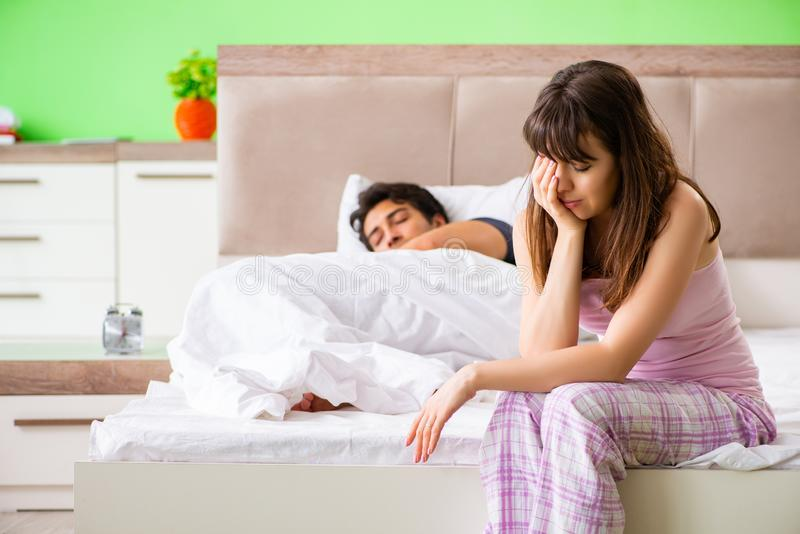 The woman and man in the bedroom after conflict. Woman and men in the bedroom after conflict royalty free stock photos