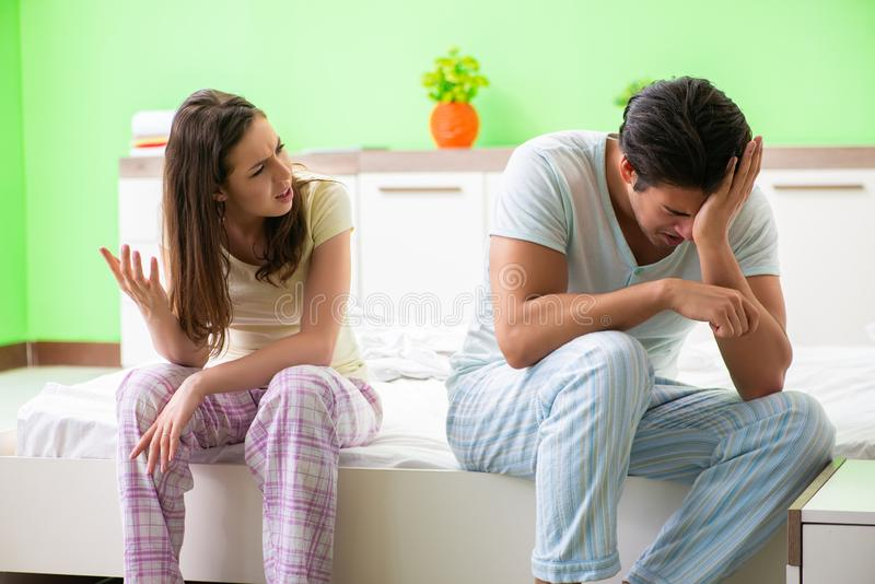 The woman and man in the bedroom during conflict. Woman and men in the bedroom during conflict stock photography