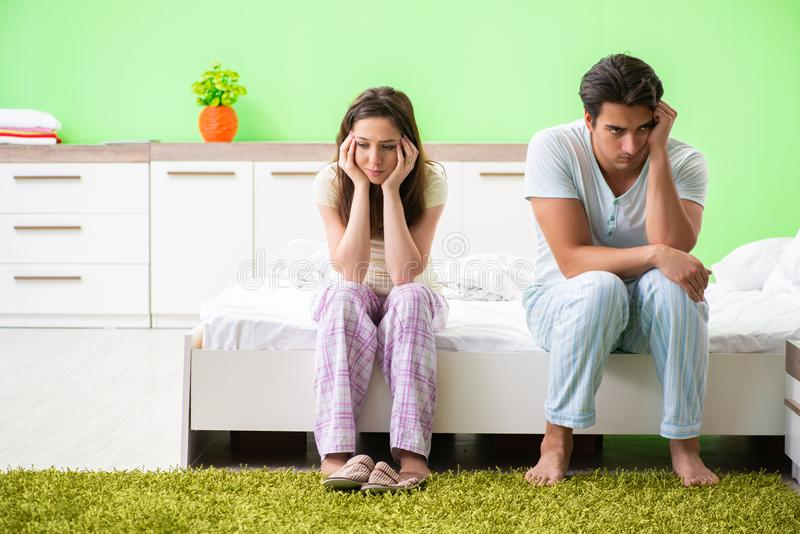 The woman and man in the bedroom after conflict. Woman and men in the bedroom after conflict stock photos