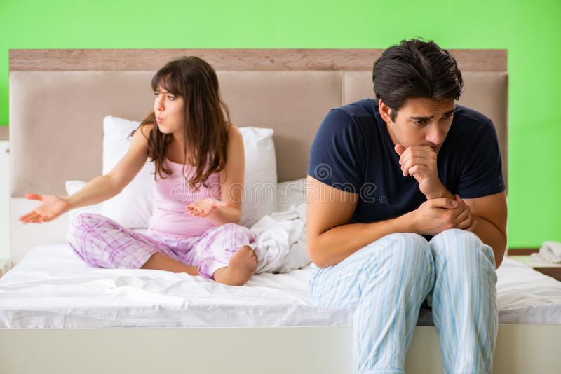 The woman and man in the bedroom during conflict. Woman and men in the bedroom during conflict stock photos