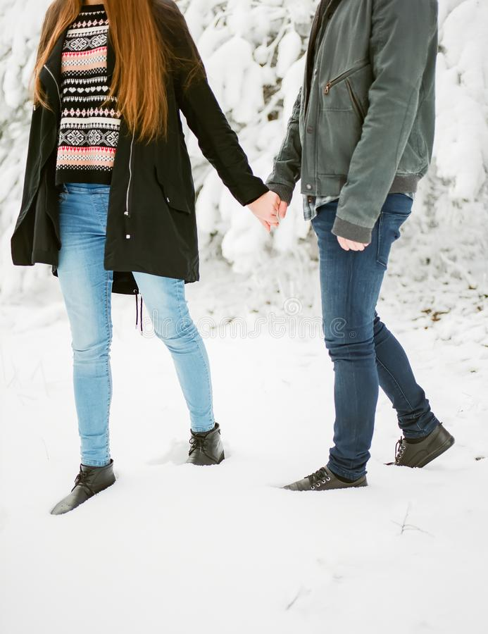 Woman and men couple winter adventures. Winter love story stock photography