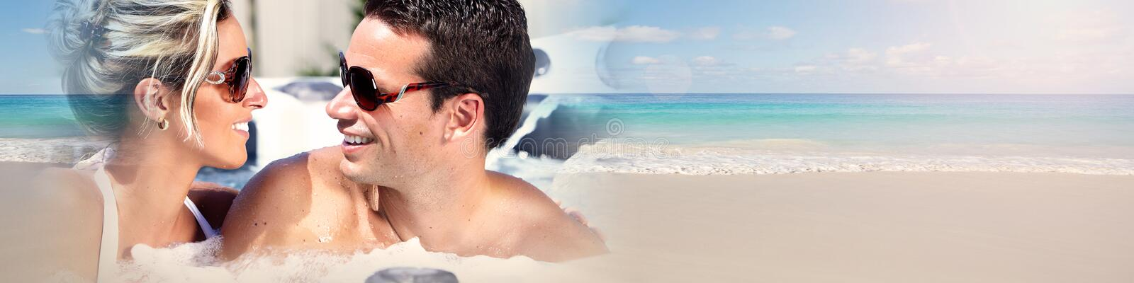 Young couple on beach. Woman and men happy couple sunbathing on the beach royalty free stock image