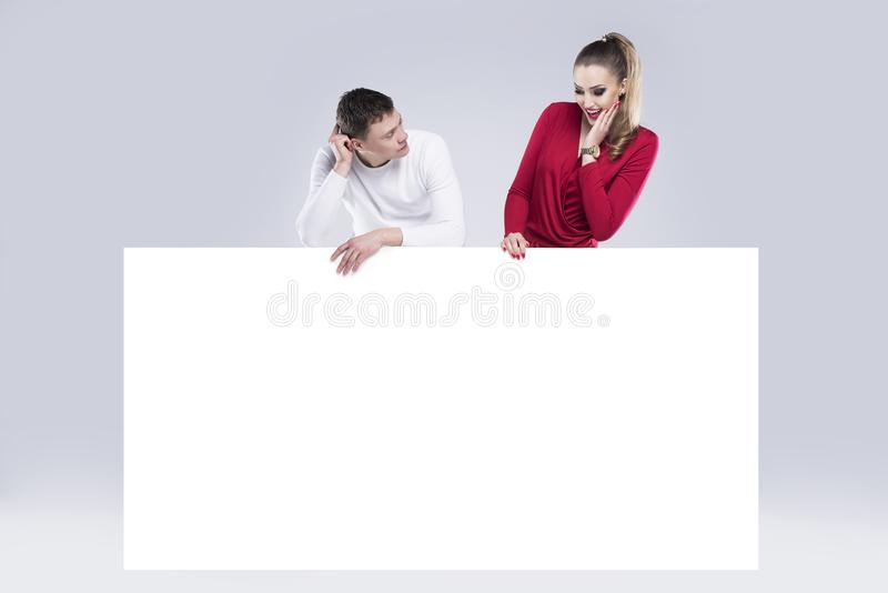 Woman and a man are holding a white banner royalty free stock photos