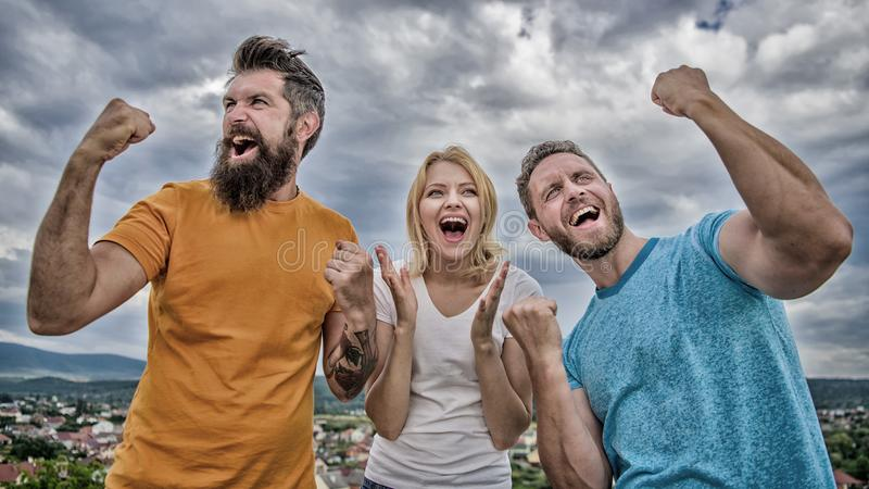 Woman and men look emotional successful celebrate victory sky background. We are winners. Celebrate success. Behavior. Successful team. Emotional explosion stock photography